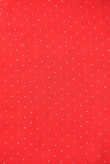 Background of red fabric with white polka dots background