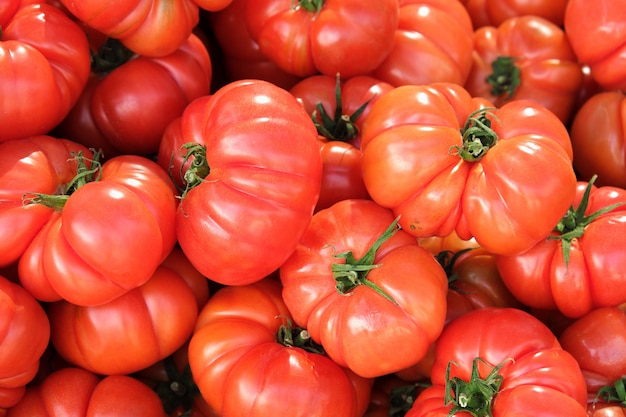 Background of ripe tomatoes at local market in southern spain