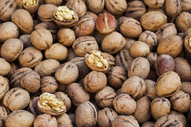 Background of ripe walnuts on the market. healthy organic food