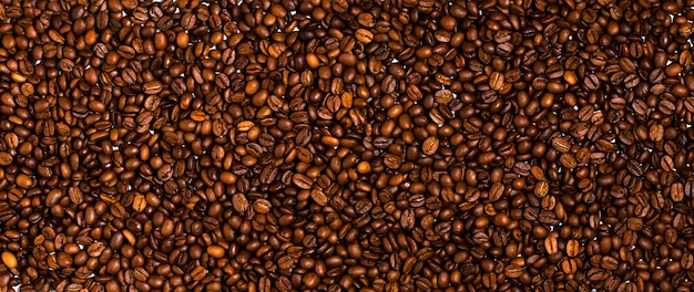 Background of roasted coffee beans. close up