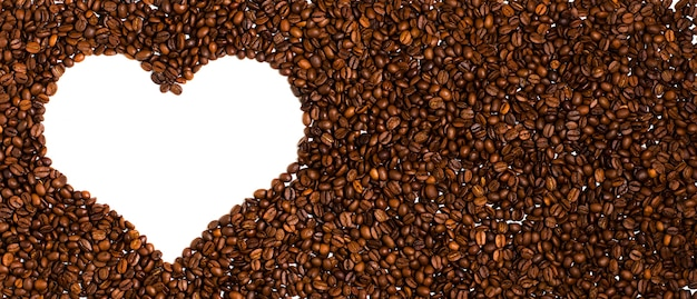 Background of roasted coffee beans. space for text in the shape of a heart.