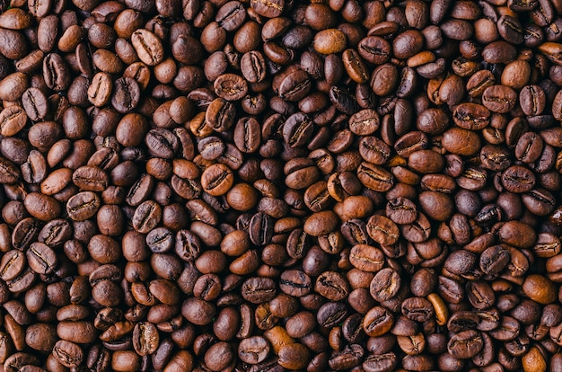 Background of roasted fresh brown coffee beans - perfect for a cool wallpaper