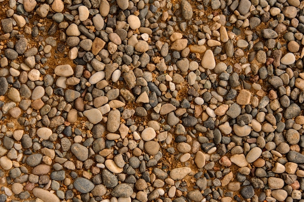 Background of round and oval brown sea pebbles