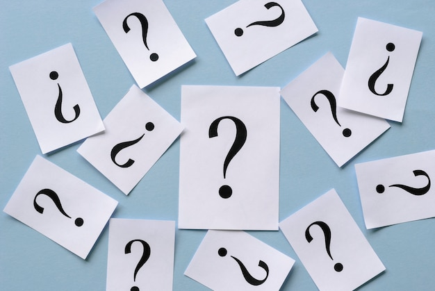 Background of scattered printed question marks
