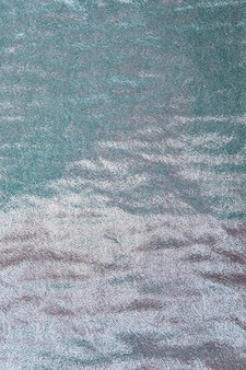 Background of seamless turquoise sequin
