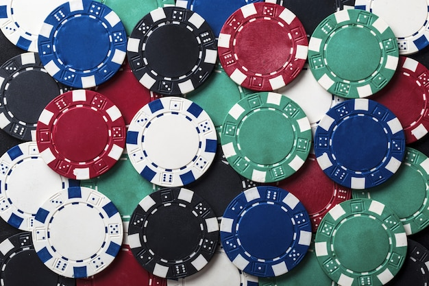 Background of set of colored chips for playing poker