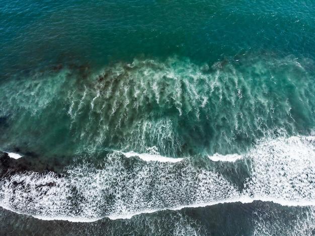 Background shot of aqua sea water surface.