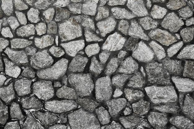 背景の石のタイル灰色の石の柵