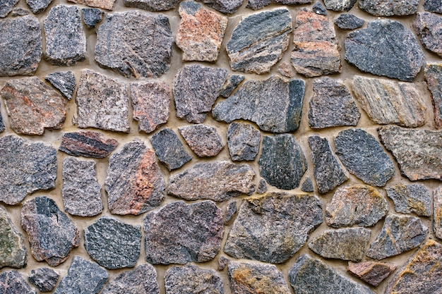 Background of a stone wall cladding texture, brown stone bricks