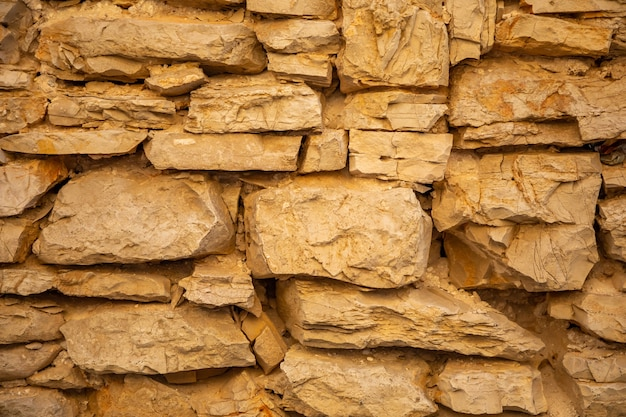 Background of stone wall texture of architecture in old town of vela luka, korcula island in croatia
