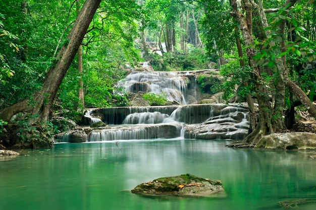 Background of streaming waterfall in national park in deep forest jungle on mountain. st o