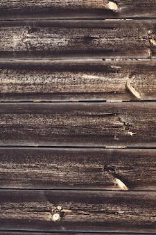 背景のテクスチャ。釘で老化した茶色の板の表面。スペースをコピーします。垂直