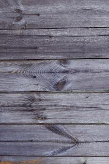 背景のテクスチャ。釘で老化した灰色の板の表面。スペースをコピーします。垂直