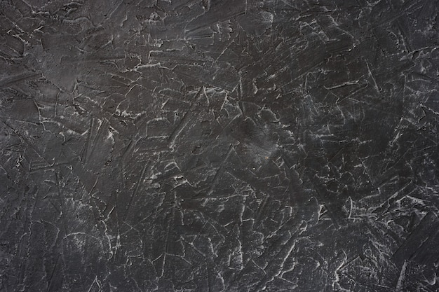 Background texture of black stucco with white veins,