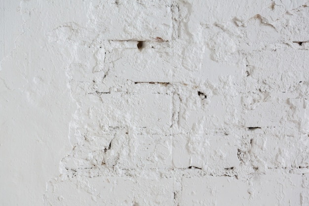Background and texture brick wall painted with white paint or hard putty