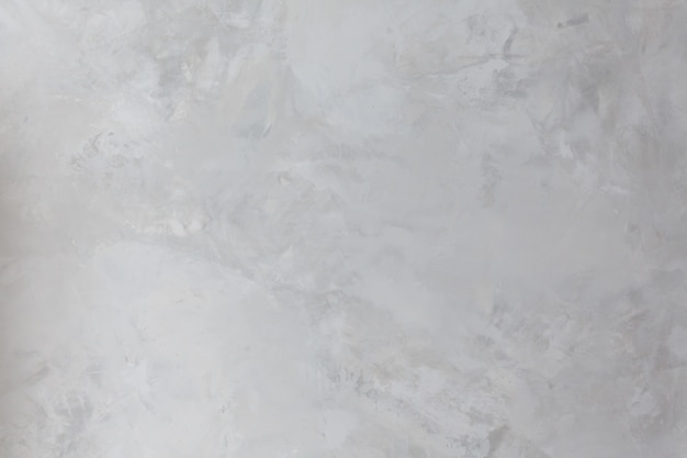 Background and texture of concrete wall painted with paint in gray