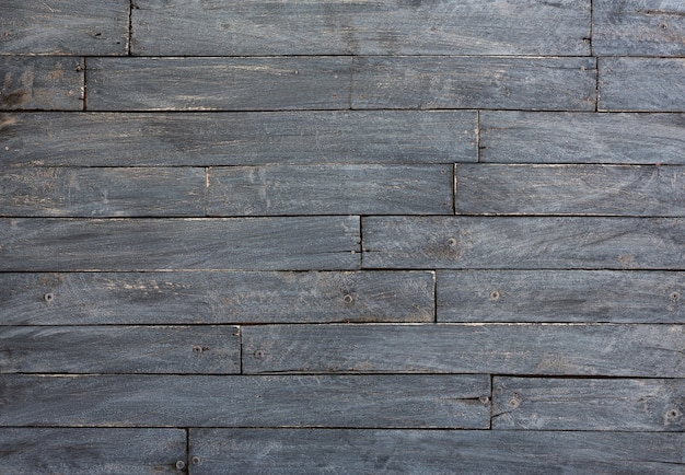 Background and texture of decorative black wooden barn wall