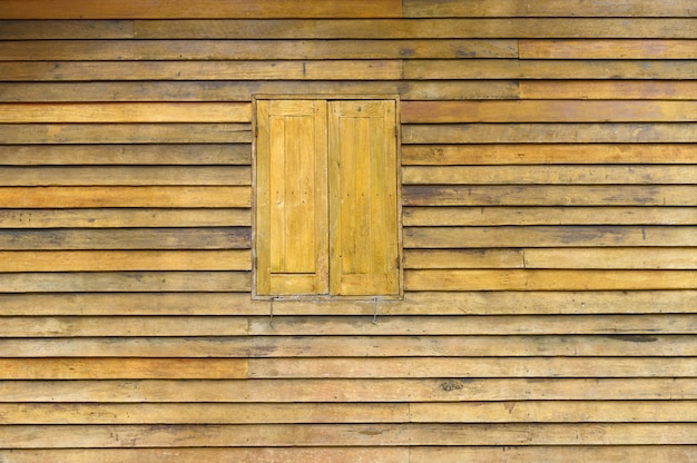 Background texture detail of old natural wooden window thai style.