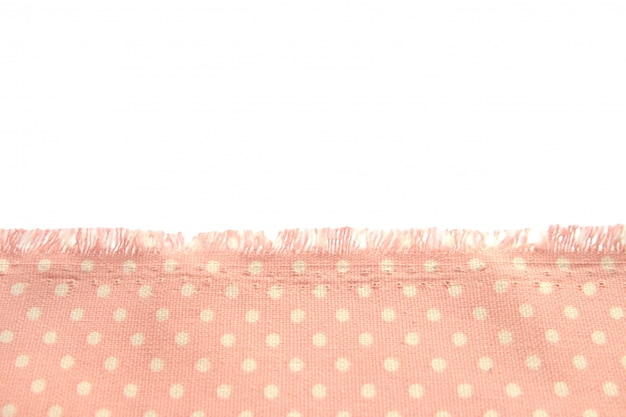 Background and texture of dusty cotton fabric with beige polka dots with fringe along the edge