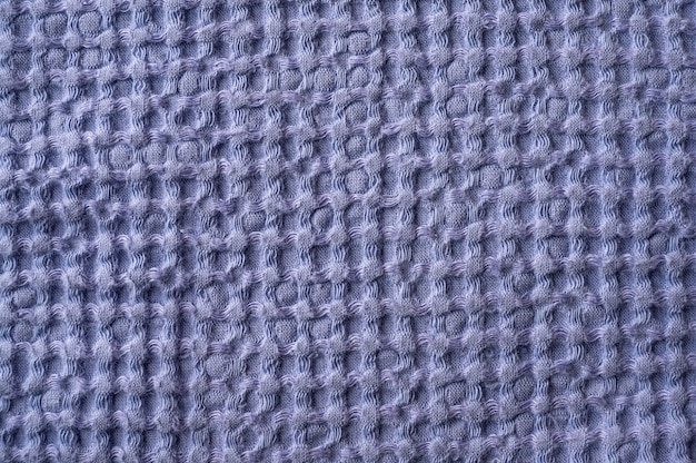 Background texture in the form of a mesh of linen and cotton towels close up selective focus
