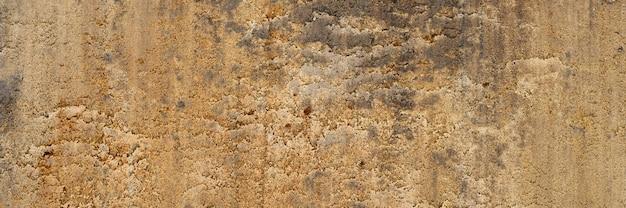 砂の滑らかな表面からの背景テクスチャ