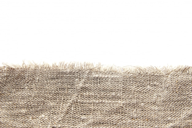 Background and texture of gray coarse linen fabric with close weaving and fringe along the edge