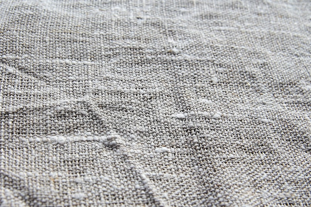 Background and texture is gray coarse linen fabric with a close weave slightly rumpled.