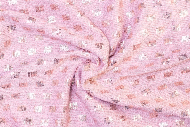Background texture of knitted soft pink fabric with sequins. beautiful background