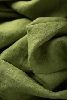 Background texture of linen fabric in green color. sewing concept