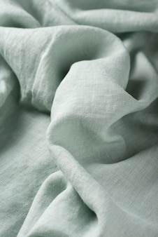 Background texture of linen fabric in light green color. sewing concept