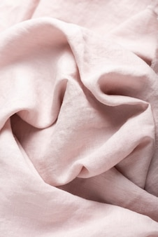 Background texture of linen fabric in natural light pink color. sewing concept