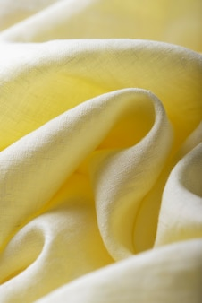 Background texture of linen fabric in yellow color. sewing concept