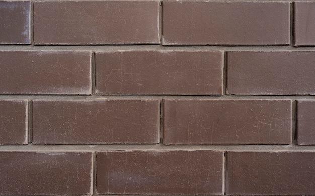 높은 해상도에서 디자인 사용을 위해 갈색 벽돌로 만든 배경 질감, 벽돌 패턴을 닫습니다.