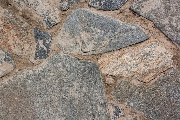 Кладка текстуры фона из крупных камней с цементом. горизонтальное изображение.