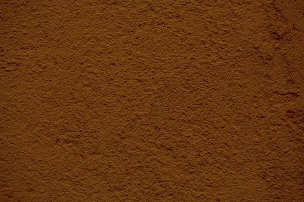 Фоновая текстура грубой отделки бетонной стены окрашена в красно-коричневый цвет