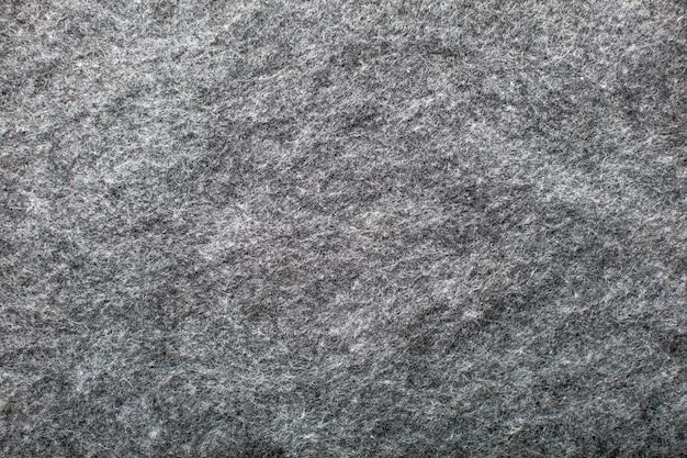 灰色のウール生地の背景の質感