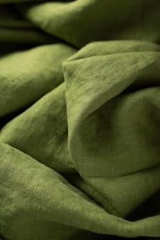 Фоновая текстура льняной ткани зеленого цвета. концепция шитья