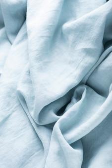 Фоновая текстура льняной ткани светло-голубого цвета. концепция шитья
