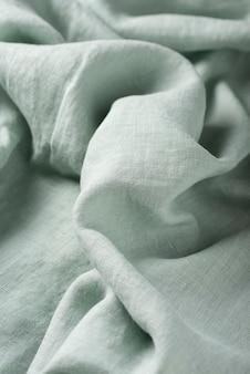 Фоновая текстура льняной ткани светло-зеленого цвета. концепция шитья