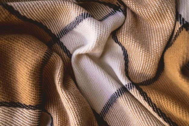 Фоновая текстура теплого клетчатого шерстяного пледа.
