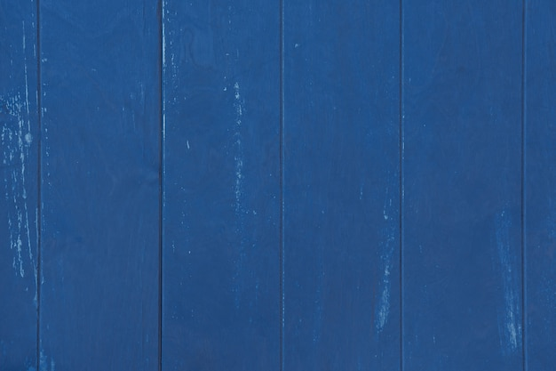 Background and texture of old boards painted in trendy classic blue