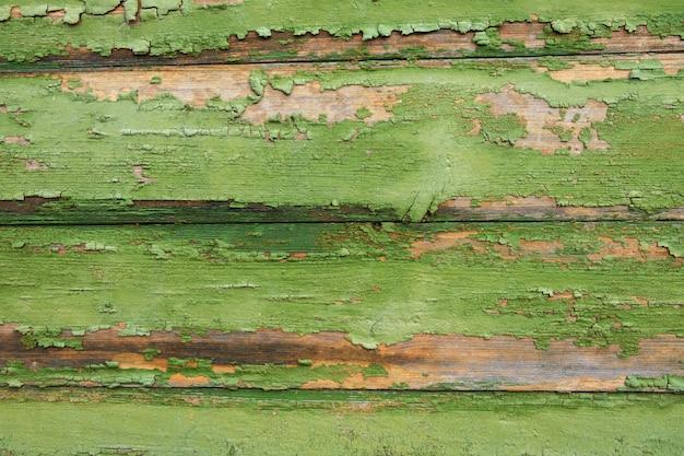 背景、テクスチャ。緑のペンキの残骸が付いている古い水平板