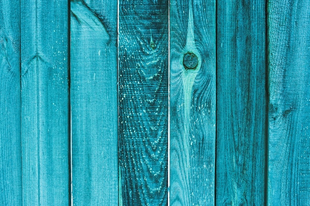 Background and texture  old wooden turquoise fence