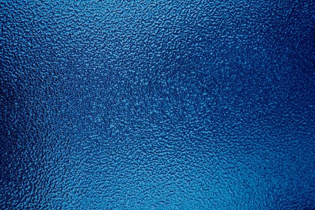 背景、テクスチャ粉体塗装金属。プロジェクトとデザインの抽象的な背景。トレンドカラークラシックブルー。 2020年の色。今年の主なトレンド。ブルークリエイティブティンティング。