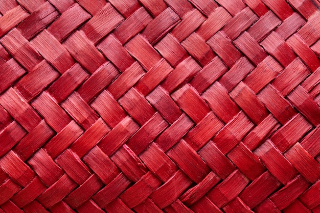 Background texture of red weaving close-up.