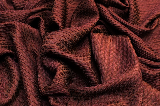 Background texture of silk fabric is dark brown top view