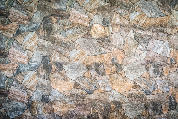 Background and texture of stacked stone wall background