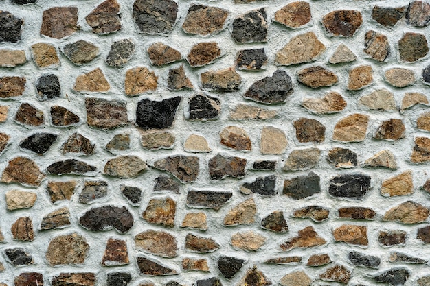 Background texture of stone wall, close up. natural stone facade, wall tiles texture
