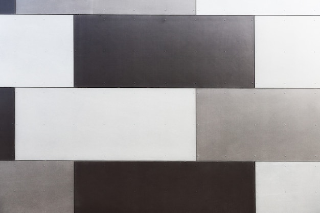 Background texture of tiled panels at the wall. modern building exterior