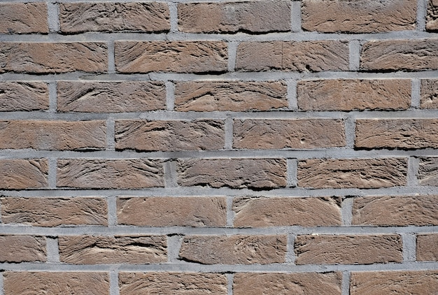 Background of texture wall from new bricks of brown color.